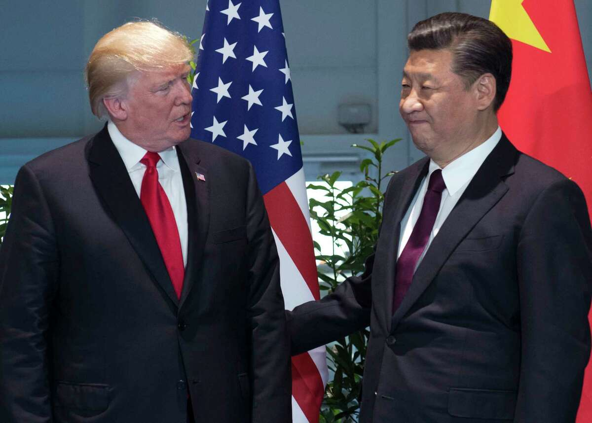 President Donald Trump, left, and China's President Xi Jinping chatted during for a July meeting on the sidelines of the G-20 Summit in Hamburg, Germany. (Saul Loeb/Pool Photo via AP, File)