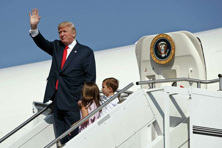 President Donald Trump waves as he deboards Air Force One with his grandchildren to begin his summer vacation at his Bedminster golf club in Morristown, N.J. Critics should stop condemning the president for taking the time off, a reader says.