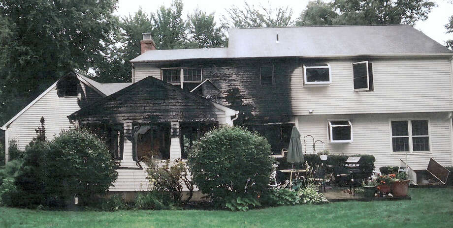 FILE - This July 2007 file photo provided by police, made available Sept. 21, 2011, by the Connecticut Judicial Branch as evidence and presented in the Joshua Komisarjevsky trial in New Haven, Conn., shows a fire-damaged portion of the William Petit home in Cheshire, Conn., where his wife Jennifer Hawke-Petit and daughters Hayley and Michaela were killed during a home invasion July 23, 2007. (AP Photo/Connecticut Judicial Branch, File) Photo: AP / AP2011