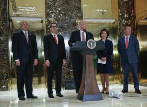 President Donald Trump speaks to the media in the lobby of Trump Tower Aug. 15 in New York. Standing with him when he seemed to confer moral equivalency to the neo-Nazis and white supremacist at Charlottesville with those protesting them were, left to right, National Economic Council Director Gary Cohn, Treasury Secretary Steven Mnuchin and Transportation Secretary Elaine Chao and OMB Director Mick Mulvaney. All should have objected to Trump's words, but, as Jews, Cohn and Mnuchin have particular responsibilities.