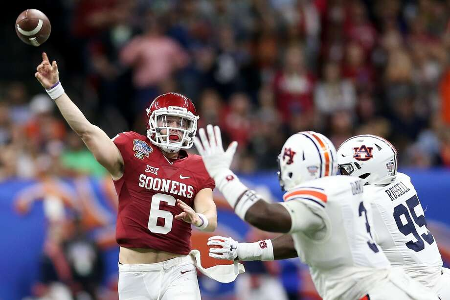 NEW ORLEANS, LA - JANUARY 02:  Baker Mayfield #6 of the Oklahoma Sooners throws a pass over Marlon Davidson #3 of the Auburn Tigers during the Allstate Sugar Bowl at the Mercedes-Benz Superdome on January 2, 2017 in New Orleans, Louisiana.  (Photo by Matthew Stockman/Getty Images) Photo: Matthew Stockman/Getty Images