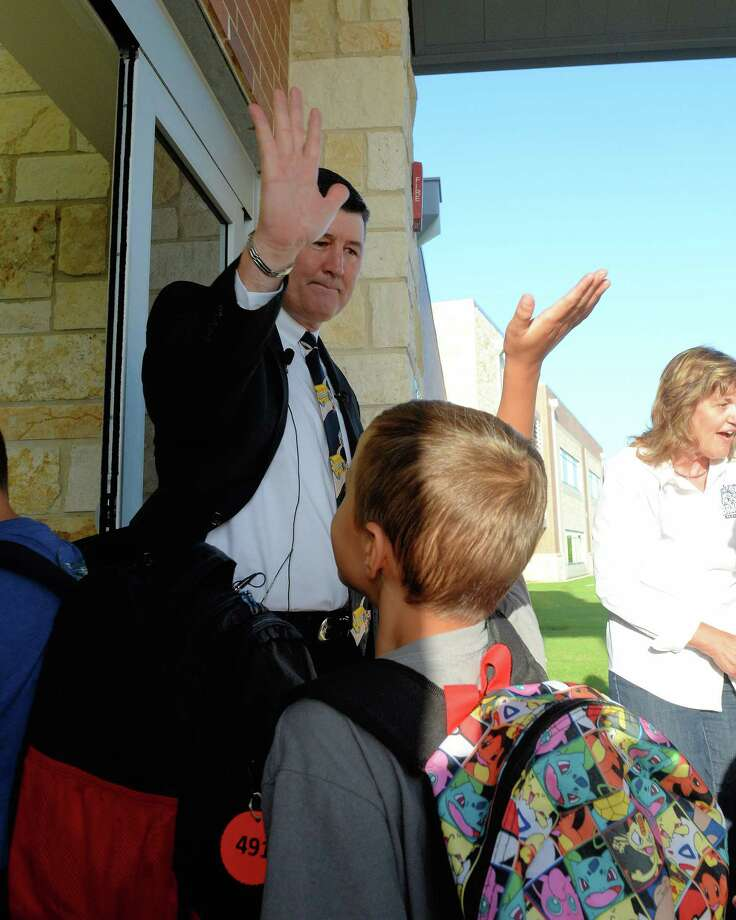 Katy ISD Superintendent Lance Hindt high-fives students as they arrive on the first day of the 2017-18 school year at Bryant Elementary School in Katy. Photo: Craig Moseley, Staff / ©2017 Houston Chronicle