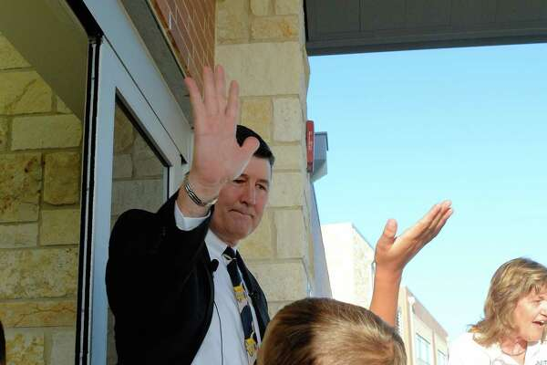 Katy ISD Superintendent Lance Hindt high-fives students as they arrive on the first day of the 2017-18 school year at Bryant Elementary School in Katy.