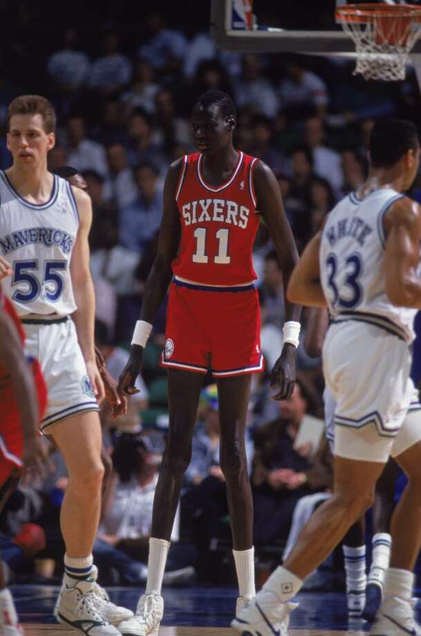 1990:  Manute Bol #11 of the Philadelphia 76ers moves on the floor during the game against the Dallas Mavericks NOTE TO USER: User expressly acknowledges and agrees that, by downloading and/or using this Photograph, User is consenting to the terms and conditions of the Getty Images License Agreement. Mandatory copyright notice: Copyright 2001 NBAE Photo: Joe Patronite, Getty Images / Getty Images North America