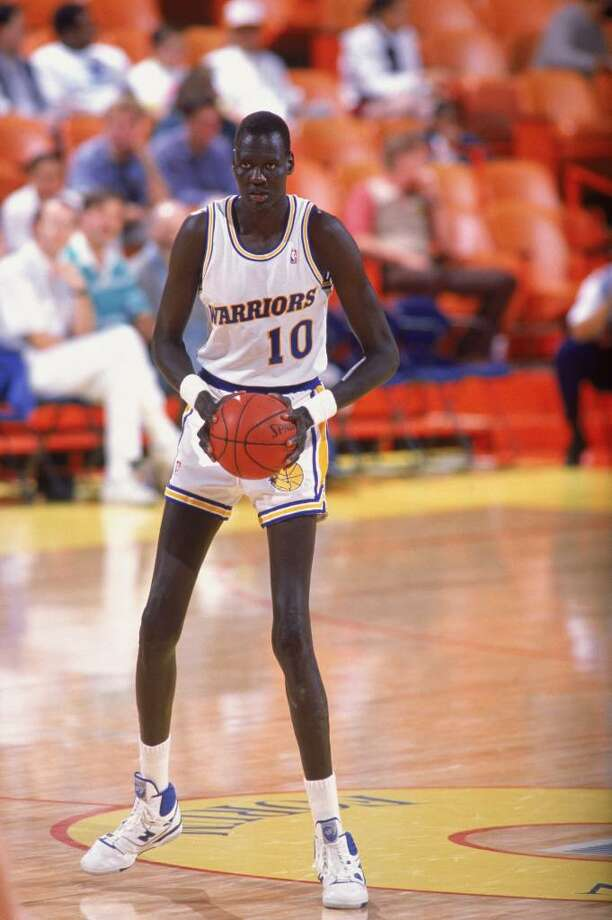 Manute Bol #10 of the Golden Sate Warriors looks to move the ball during a game. (Photo by Mike Powell/Getty Images) Photo: Mike Powell, Getty Images / Getty Images North America