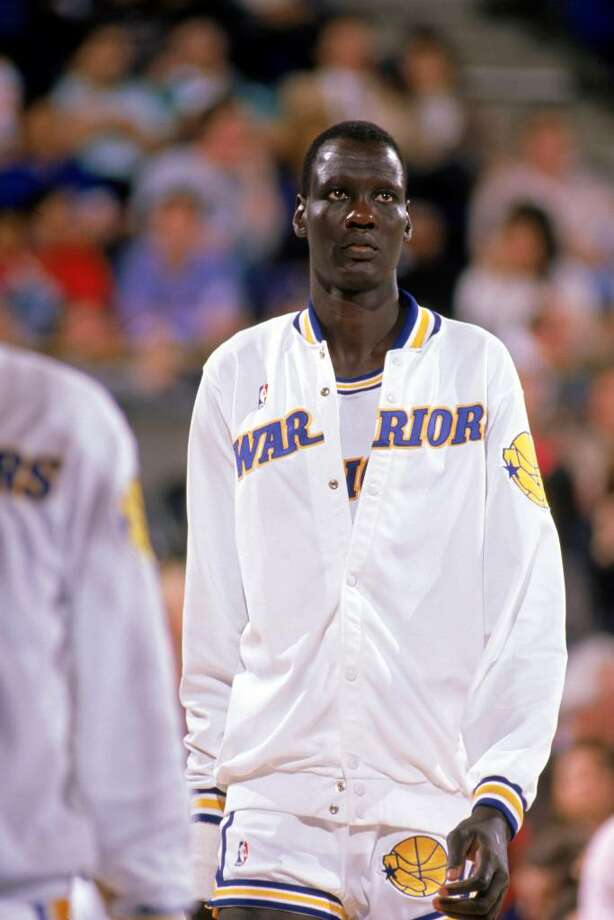 1988:  Manute Bol #10 of the Golden State Warriors walks to the court during an NBA game in the 1988-89 season. NOTE TO USER: User expressly acknowledges and agrees that, by downloading and/or using this Photograph, User is consenting to the terms and conditions of the Getty Images License Agreement. (Photo by: Otto Greule Jr/Getty Images Photo: Otto Greule Jr, Getty Images / 1988 Getty Images
