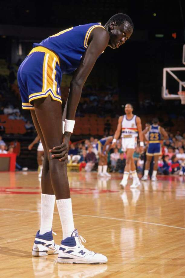 1988:  Manute Bol #10 of the Golden State Warriors rests on the court during an NBA game in the 1988-89 season. NOTE TO USER: User expressly acknowledges and agrees that, by downloading and/or using this Photograph, User is consenting to the terms and conditions of the Getty Images License Agreement. (Photo by: Tim DeFrisco/Getty Images Photo: Tim DeFrisco, Getty Images / 1988 Getty Images