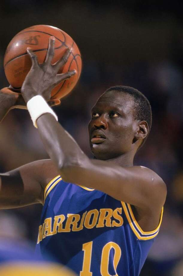 1988:  Manute Bol #10 of the Golden State Warriors looks to shoot during an NBA game in the 1988-89 season. NOTE TO USER: User expressly acknowledges and agrees that, by downloading and/or using this Photograph, User is consenting to the terms and conditions of the Getty Images License Agreement. (Photo by: Ken Levine/Getty Images Photo: Ken Levine, Getty Images / 1988 Getty Images
