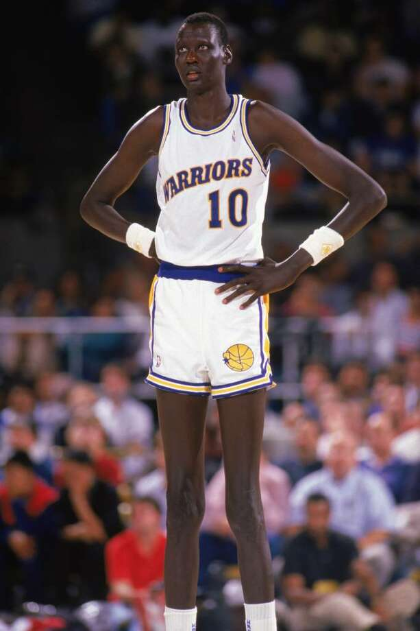 1988:  Manute Bol #10 of the Golden State Warriors looks on during an NBA game in the 1988-89 season. NOTE TO USER: User expressly acknowledges and agrees that, by downloading and/or using this Photograph, User is consenting to the terms and conditions of the Getty Images License Agreement. (Photo by: Otto Greule Jr/Getty Images Photo: Otto Greule Jr, Getty Images / 1988 Getty Images