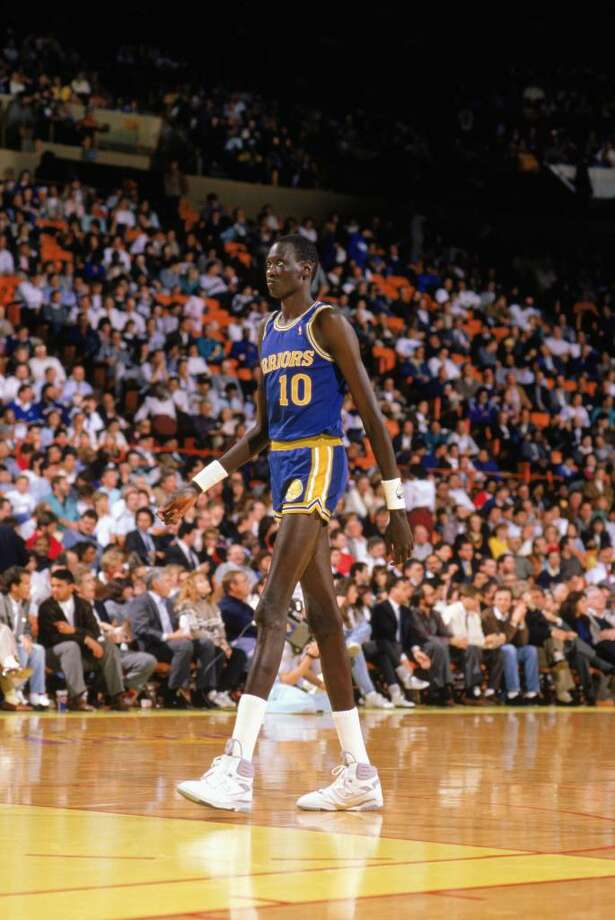 1988:  Manute Bol #10 of the Golden State Warriors walks on the court during an NBA game in the 1988-89 season. NOTE TO USER: User expressly acknowledges and agrees that, by downloading and/or using this Photograph, User is consenting to the terms and conditions of the Getty Images License Agreement. (Photo by: Tim DeFrisco/Getty Images Photo: Tim DeFrisco, Getty Images / 1988 Getty Images