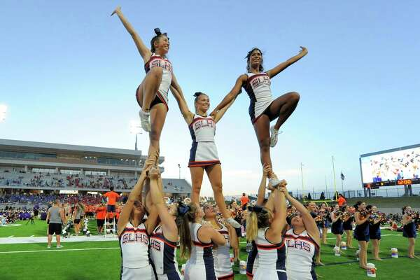 Cheerleaders from Seven Lakes High School perform at the dedication ceremony for Katy ISD's Mike Johnson Field and Legacy Stadium in Katy, TX on August 17, 2017.