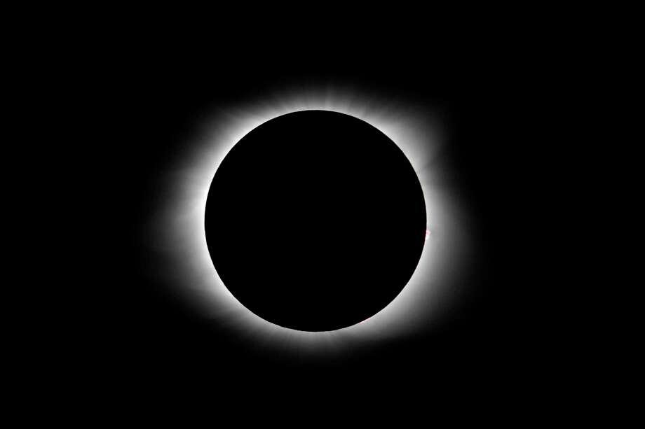 A total solar eclipse is seen in Pelzer, S.C., as a the celestial phenomenon leaves the United States after crossing the country, Monday, Aug. 21, 2017. (AP Photo/Julio Cortez) Photo: Julio Cortez, STF / Copyright 2017 The Associated Press. All rights reserved.