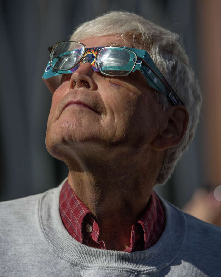 Spectators watch the 2017 solar eclipse through special glasses, at the Pacific Science Center in Seattle on Monday, Aug. 21, 2017. Photo: GRANT HINDSLEY, SEATTLEPI.COM / SEATTLEPI.COM