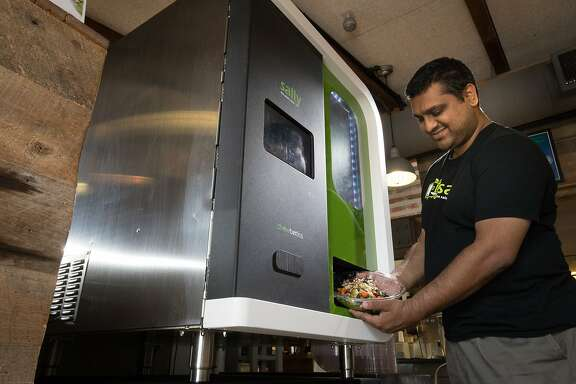 Deepak Sekar, CEO, founder, Chowbotics demonstrates a robot made by startup Chowbotics making a salad at Calafia Cafe in the Town and Country Village shopping center on Monday, Aug. 21, 2017 in Palo Alto, CA.