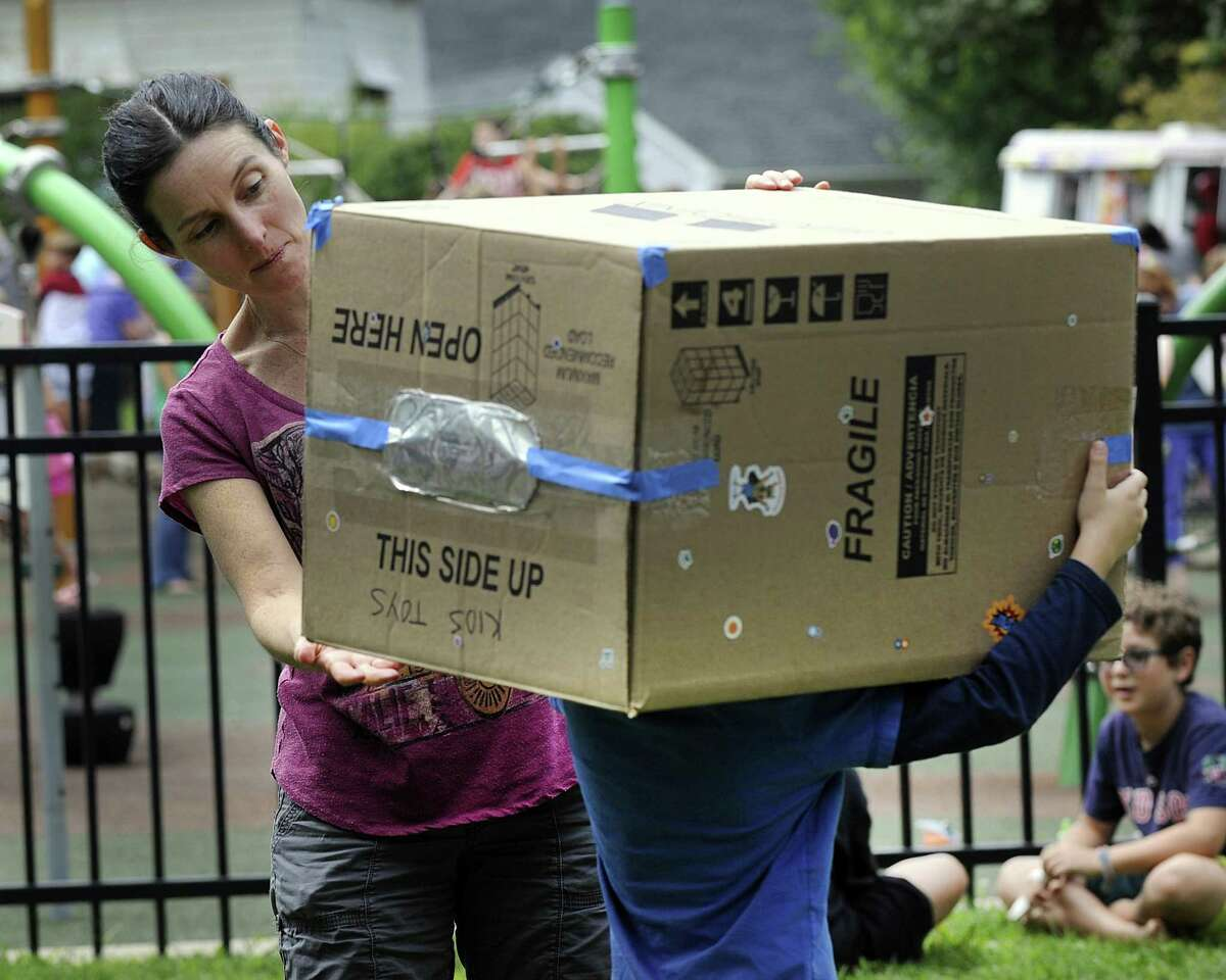 Melissa Axen of Ridgefield, holds a cardboard box, rigged for safe viewing of the solar eclipse, for son Ben, at Ballard Park in Ridgefield monday, August 21, 2017.