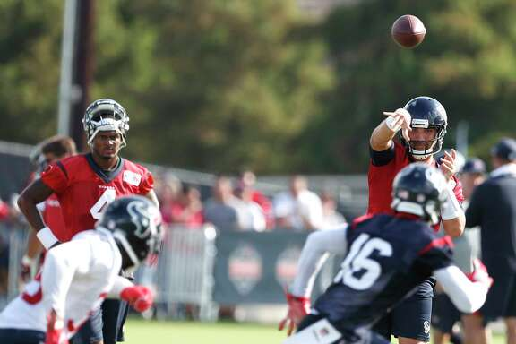 Houston Texans quarterback Tom Savage (3) throws a pass to Houston Texans wide receiver Germone Hopper (16) during training camp at The Methodist Training Center on Monday, Aug. 21, 2017, in Houston. ( Brett Coomer / Houston Chronicle )