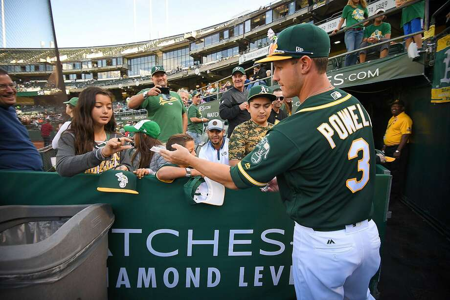 OAKLAND, CA - AUGUST 12: Boog Powell #3 of the Oakland Athletics passes out Topps trading cards to fans prior to the start of their game against the Baltimore Orioles at Oakland Alameda Coliseum on August 12, 2017 in Oakland, California. (Photo by Thearon W. Henderson/Getty Images) Photo: Thearon W. Henderson, Getty Images
