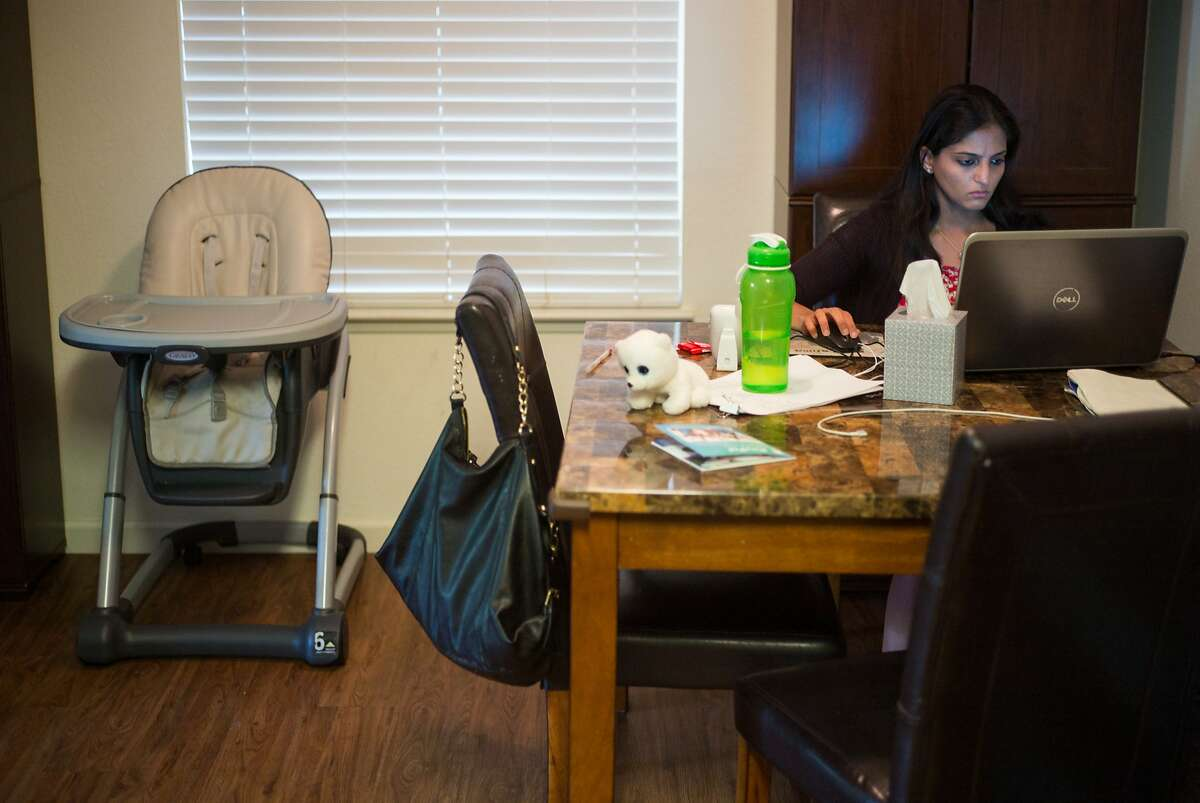Karishma Chawla works on an app from her home in San Jose in August. For decades, spouses of H-1B visa holders could not get jobs, until a rule issued two years ago granted them work permits. The Trump administration is poised to revoke that rule by the end of the year.