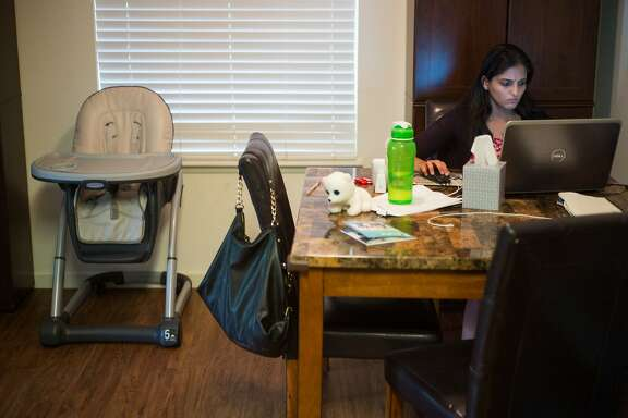 Karishma Chawla works on her app from her home in San Jose, Calif. on Friday, Aug. 18, 2017. For decades spouses of H-1B visa holders could not work, until two years ago when President Obama issued a work authorization. But now his authorization is under threat by the Trump administration who is trying to rid these visa holders from the ability to work.