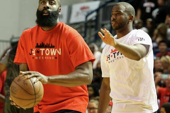 Chris Paul plays defense while warming up with James Harden for the NBA Game of James Harden charity basketball tournament at Rice University's Tudor Field House Sunday, Aug. 20, 2017, in Houston. ( Yi-Chin Lee / Houston Chronicle )