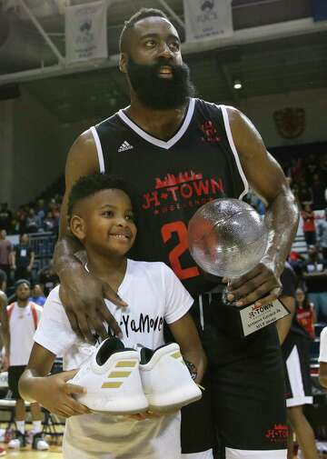 d254eb3ff21 3of4Big Tony s James Harden gives a pair of signed and worn game shoes and  the MVP award of the NBA Game of James Harden Charity Basketball Tournament  to ...
