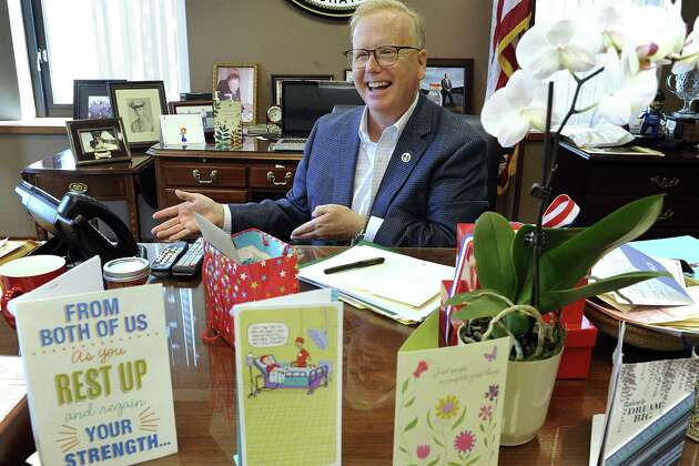 Mayor Mark Boughton returns to work at City Hall on Monday, after undergoing brain surgery. He arrives to find his office filled with cards and gifts.