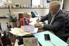 Mayor Mark Boughton returns to work at City Hall Monday, August 21, 2017, after undergoing brain surgery. He arrives to find his office filled with cards and gifts.