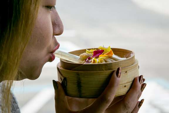 Helen Yu drinks soup from the King Dum dumpling at Dumpling Time in San Francisco, Calif., on August 19th, 2017.