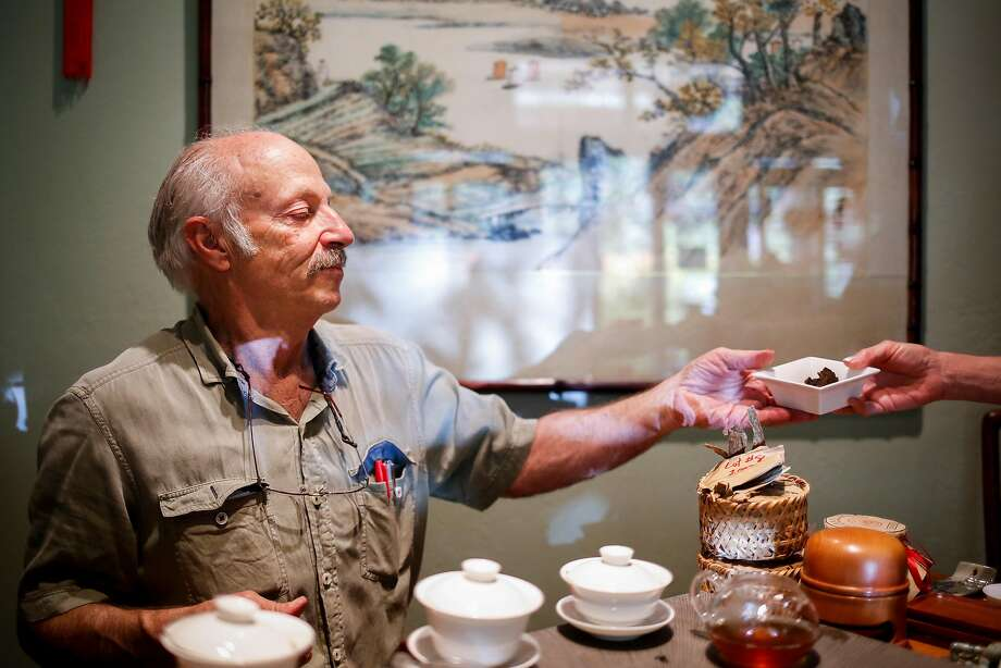 At his Tea Museum in Lagunitas, David Lee Hoffman hands tea to a customer. Photo: Nicole Boliaux, The Chronicle