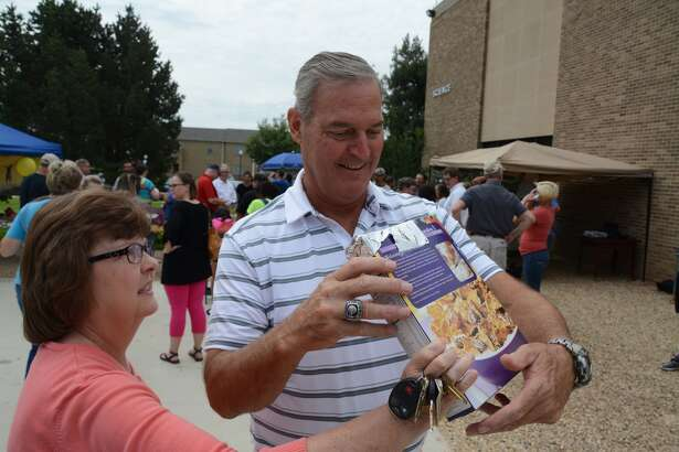 Wayland volleyball coach Jim Giacomazzi and Vickie Hughes, coordinator of tutorial services, use a cereal box to view the eclipse on Monday afternoon.