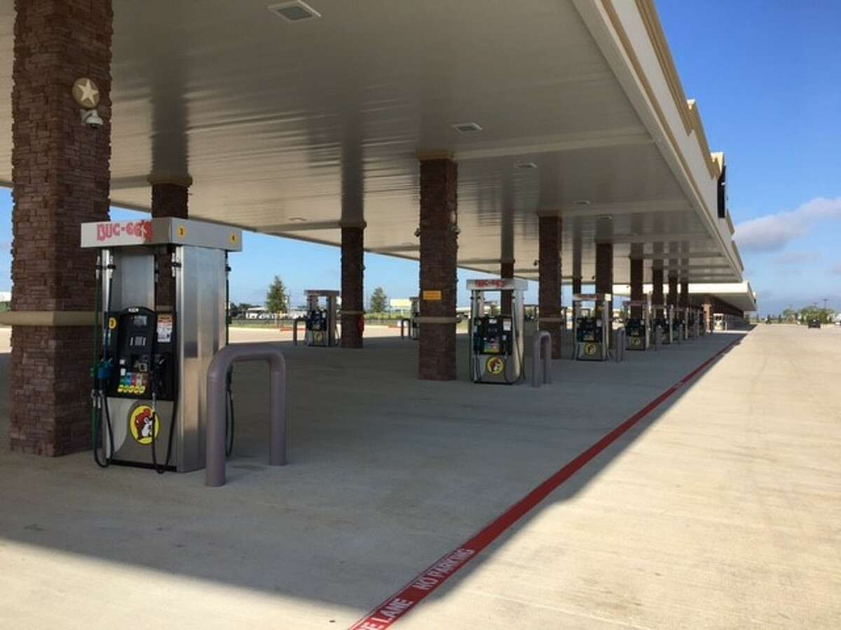 Gas pumps sit idle at the Buc-ee's in Katy, scheduled to open Aug. 28.