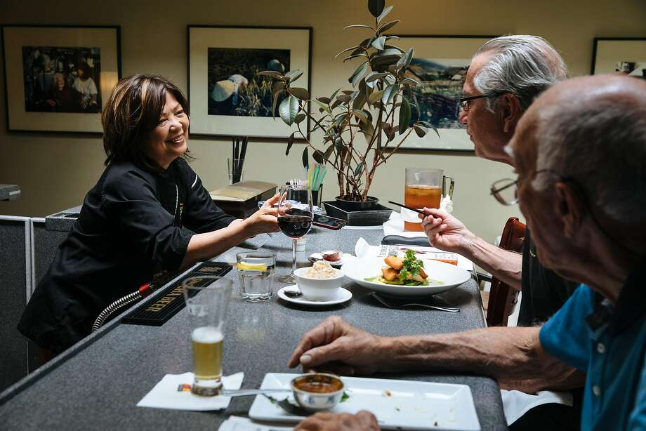 Mai Pham, owner of Lemon Grass, talks to customers Ron Leineke (right) and Gary Vercelli. Photo: Mason Trinca, Special To The Chronicle
