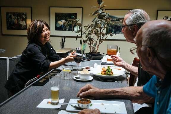 Mai Pham, owner of Lemon Grass, talks to customers, Ron Leineke, right, and Gary Vercelli, center, at Lemon Grass in Sacramento, Calif. Tuesday, August 15, 2017.