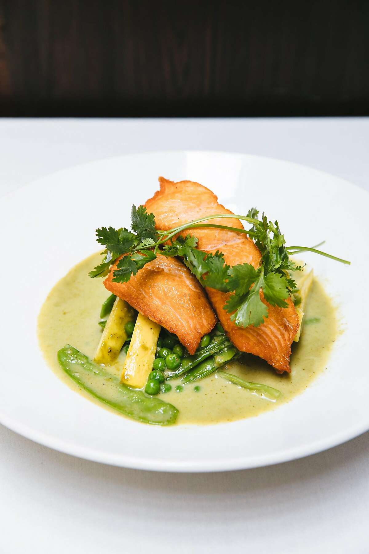 Pan-seared salmon served on homemade Thai seafood curry photographed at Lemon Grass in Sacramento, Calif. Tuesday, August 15, 2017.