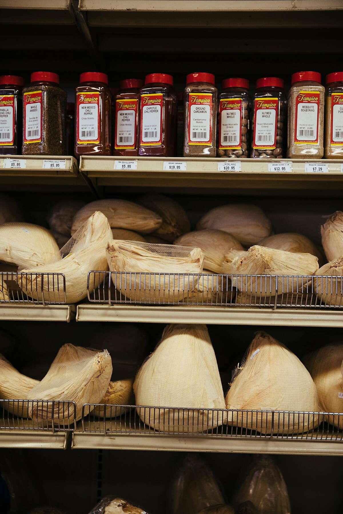 Corns husks for enchiladas are seen lining the shelves at La Esperanza Market in Sacramento, Calif. Tuesday, August 15, 2017.