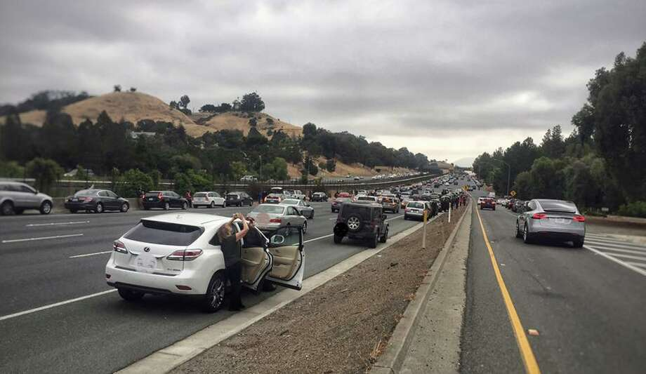 The California Highway Patrol posted this picture to their Facebook page showing cars pulled over on the roadway as people snapped pictures of the partial eclipse.The photo was altered by CHP to obscure license plates. Photo: CHP- Contra Costa