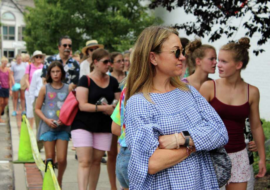 Hundreds lined up at Wilton Library for the solar eclipse viewing party on Monday, Aug. 21, 2017. Photo: Stephanie Kim / Hearst Connecticut Media