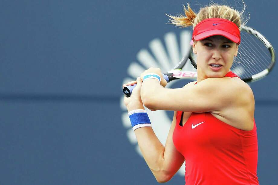 Eugenie Bouchard of Canada returns a shot to Lauren Davis of the United States Monday at the Connecticut Open at the Connecticut Tennis Center at Yale in New Haven. Photo: Maddie Meyer / Getty Images / 2017 Getty Images