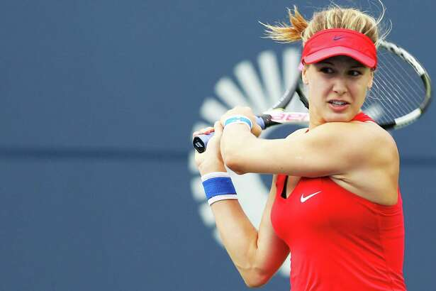 Eugenie Bouchard of Canada returns a shot to Lauren Davis of the United States Monday at the Connecticut Open at the Connecticut Tennis Center at Yale in New Haven.