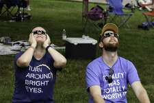 Westyn and Brendan Gibbons model Eclipse fashion at Cosmo Park in Columbia, Missouri, on August 21, 2017. Without special glasses, people watching the eclipse could damage their eyes.