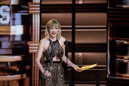 Taylor Swift presents Entertainer of the Year to Garth Brooks at the 50th Annual CMA Awards that took place at the Bridgestone Arena on Nov. 2, 2016 in downtown Nashville, Tenn. Closing arguments in Swift's civil trial against former radio host David Mueller were held on Aug. 14, 2017. (Jason Walle/Zuma Press/TNS)