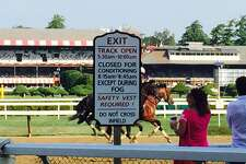 If you are watching workouts at the main track at Saratoga Race Course, this is all you need to know. The sign gives you all the particulars. Monday was a particularly spectacular morning as the horses went through their paces at the Spa. Hard to believe, but we only have 12 racing days left of this meet. Don't know where the summer has gone. But we still have some pretty good days of racing left. (Tim Wilkin / Times Union)