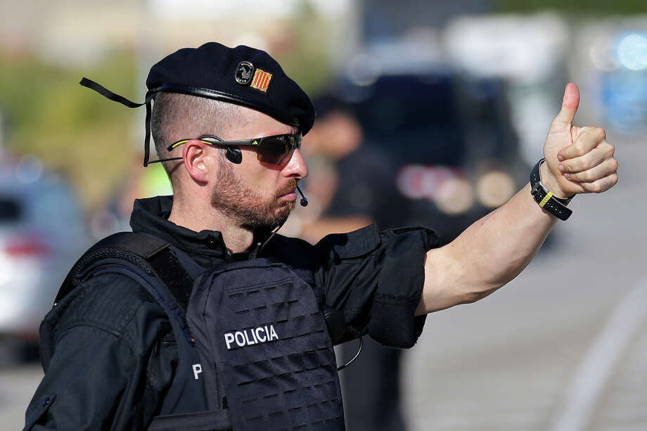 Regional police in Spain have confirmed that fugitive van suspect Younes Abouyaaqoub was shot dead Monday in Subirats, Spain. Police say he wore a fake suicide belt and had a bag of knives when police asked for his identification. Photo: Manu Fernandez, STR / Copyright 2017 The Associated Press. All rights reserved.
