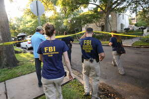 "FBI, Bureau of Alcohol, Tobacco, Firearms and Explosives (ATF), and Houston Police work at the scene of a ""law enforcement operation"" led by the FBI on the 2000 block of Albans Road Monday, Aug. 21, 2017, in Houston. Andrew Schneck of Houston was arrested Saturday night, Aug. 19, after a Houston park ranger spotted him kneeling in bushes in front of the statue of Confederate officer Richard Dowling in Hermann Park. He has been charged with trying to plant explosives at the statue of Confederate officer Richard Dowling in the park, federal officials said Monday. (Godofredo A. Vasquez/Houston Chronicle via AP)"