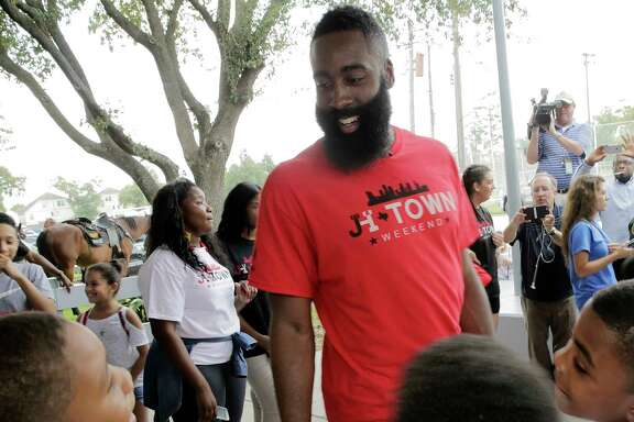 James Harden's summer activities in Houston included a visit to the Boys & Girls Club on Friday,  delivering backpacks and supplies to 150 children.