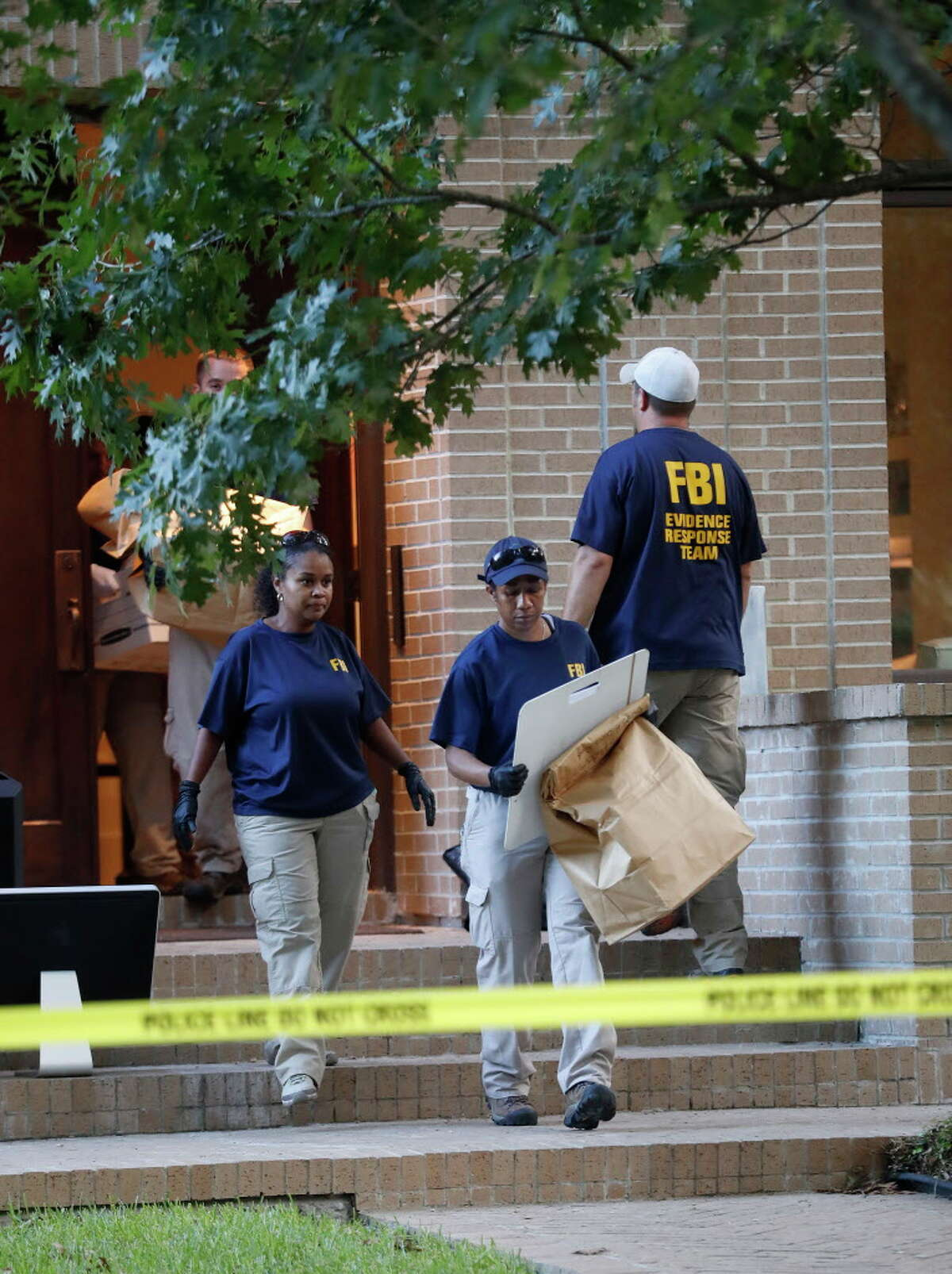 FBI agents take bags of evidence out of a house at 2025 Albans, Monday, Aug. 21, 2017, in Houston. Earlier in the day, the ATF, FBI and Houston Police conducted a controlled explosion at the house next door at 2021 Albans.