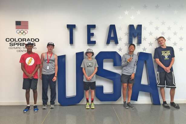 Father McGivney freshmen, from left, Tyler Guthrie, Ross Bushur, Tanner Fox and Diego Pacheco and senior Alex Loeffler pose for a photo during a visit to the U.S. Olympic Training Center in Colorado Springs, Colo. Guthrie and Bushur were attending a cross country camp.