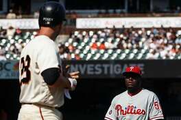SAN FRANCISCO, CA - AUGUST 20: Buster Posey #28 of the San Francisco Giants stares at Hector Neris #50 of the Philadelphia Phillies after getting hit by a pitch during the eighth inning at AT&T Park on August 20, 2017 in San Francisco, California. The Philadelphia Phillies defeated the San Francisco Giants 5-2.  (Photo by Jason O. Watson/Getty Images)