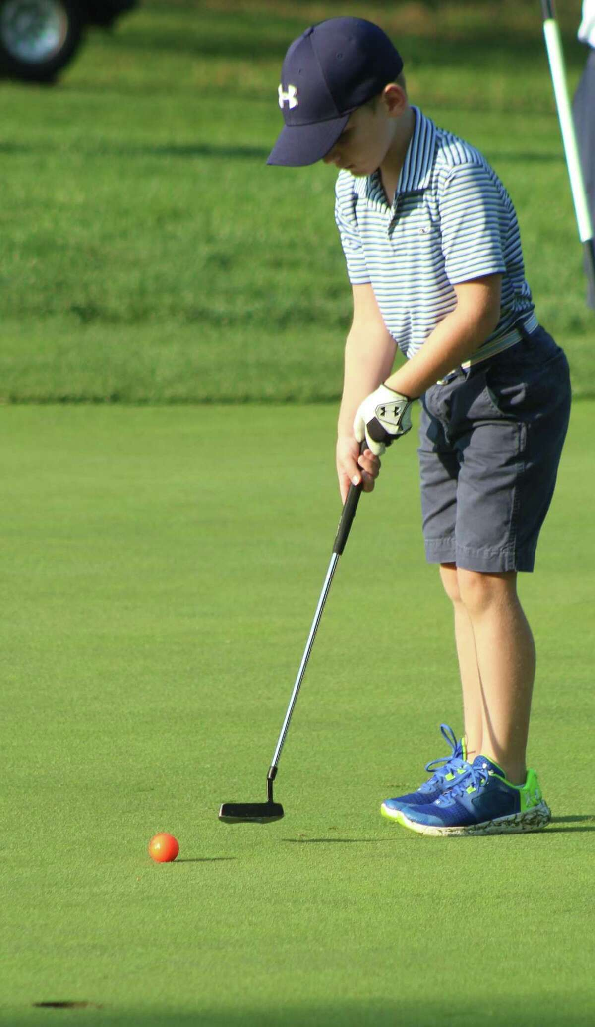 Jack Schonfeld putts on the 18th green at the Fran McCarthy Junior Golf Tournament at Richter Park Golf Course in Danbury Aug. 21, 2017.