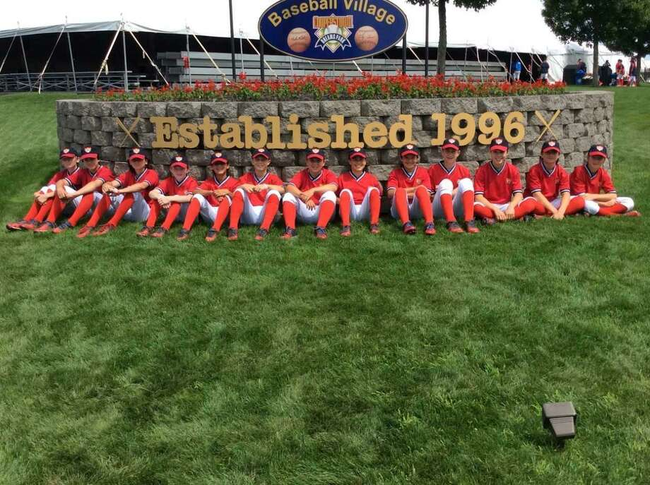 The Old Greenwich-Riverside Community Center Thunder Blue Under-12 baseball team gathers at Cooperstown Dreams Park Baseball Village in Cooperstown, N.Y., where they competed in a tournament. Photo: Contributed Photo